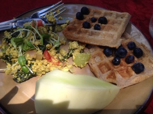 The menu included homemade vegan waffles with blueberries, tofu scramble, and a side of melon.