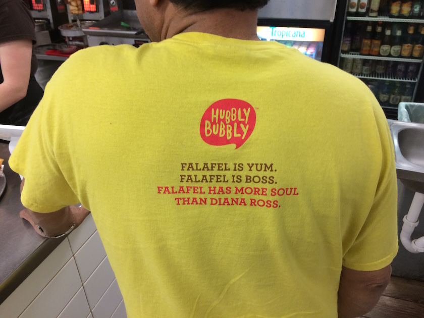 After seeing me take a photo of one of the employee's shirts, this gentlemen, who I believe is the owner, turned around so I could take a picture of his too. I was expecting for it to be the same, but it wasn't. What a great touch!