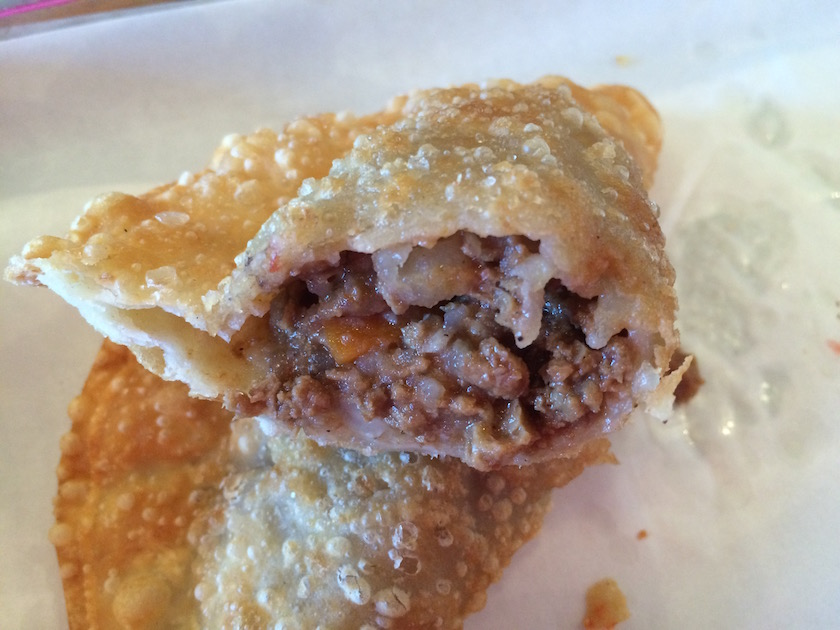 "Okay, here is an ""inside look"" at the Vegan Empanada. It is stuffed with soy crumbles, carrots, raisins, and onions. I saved one for the next day, and it was even better!"