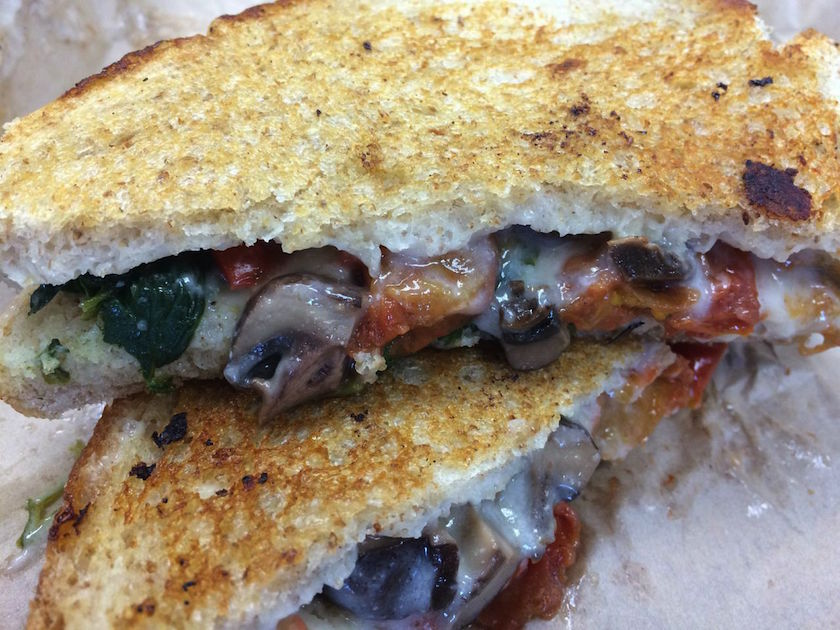 Here is my Roasted Vegetable Grilled Cheese Sandwich up close and personal. The veggies are literally spilling out of the sandwich. I think that is a pretty good sign! Portobello mushrooms, tomato chutney, and garlic spinach were stuffed in with the house-made vegan cheese.